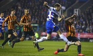 Jamie Mackie fires home during Reading's 3-0 Quarter-Final replay win over Bradford City